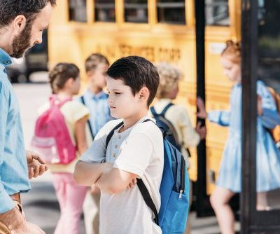 How to avoid the classroom power struggle image showing teacher or father reprimanding boy student outside
